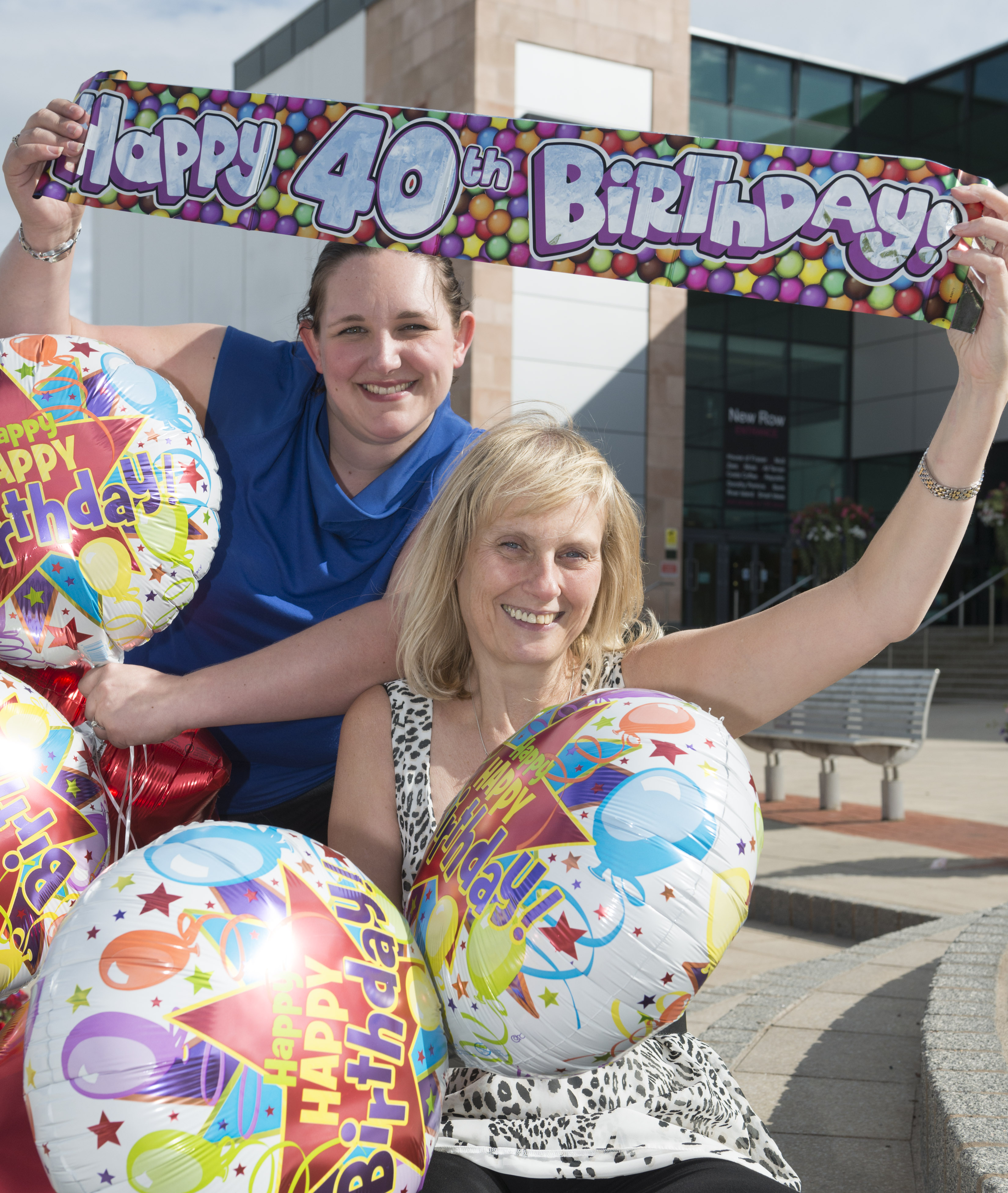 Emma Meredith and Tracy Hadley invite customers to join the 40th birthday celebrations at Telford Shopping Centre