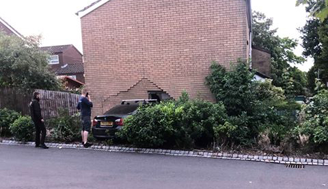 Two taken to hospital as BMW smashes into house