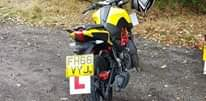 """Image may contain: one or more people, motorcycle and outdoor, text that says """"ט VYJ. FH66"""""""